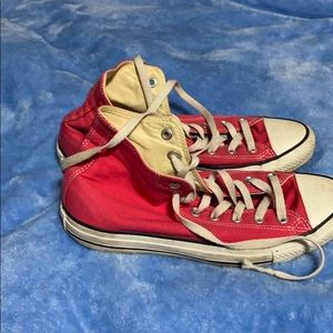 Bright pink high top converse